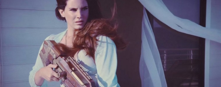 Lana Del Rey Guns Down Paparazzi in 'High By The Beach' Video