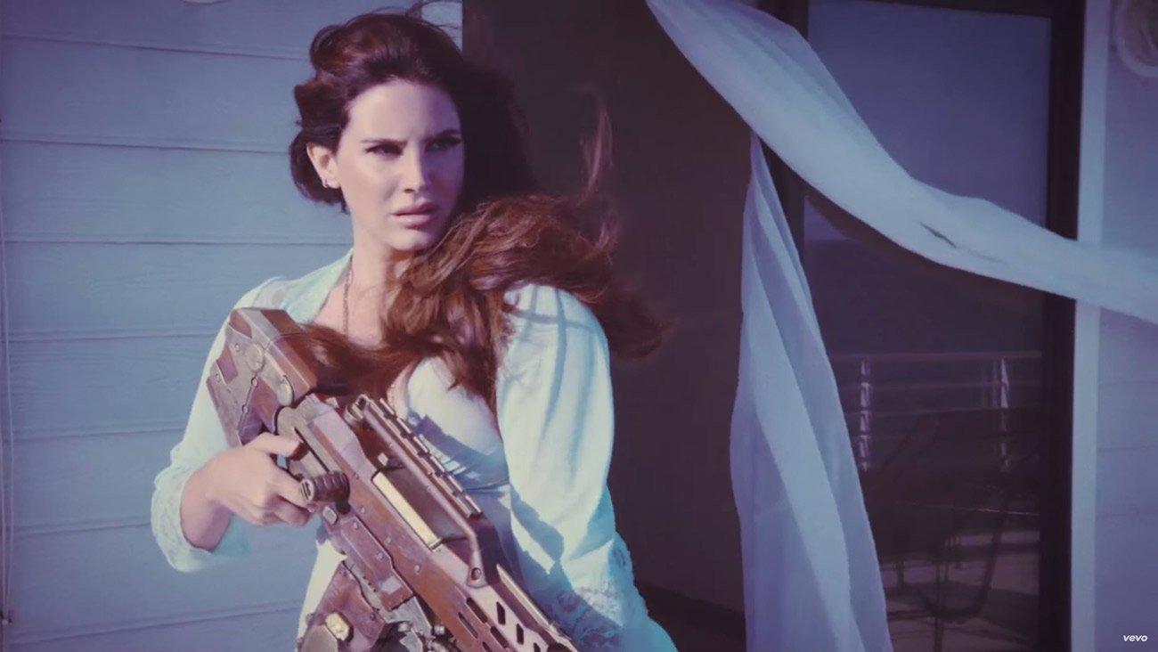 Lana Del Rey Guns Down Paparazzi in 'High By The Beach' Video